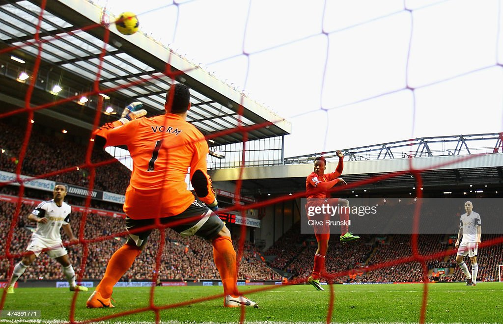 Daniel Sturridge of Liverpool scores his team's third goal during the Barclays Premier League match between Liverpool and Swansea City at Anfield on February 23, 2014 in Liverpool, England.