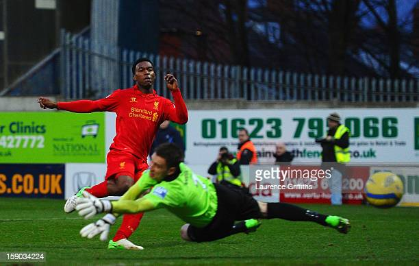 Daniel Sturridge of Liverpool scores past Alan Marriott of Mansfield Town during the FA Cup with Budweiser Third Round match between Mansfield Town...