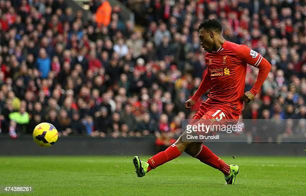 Daniel Sturridge of Liverpool scores the first goal during the Barclays Premier League match between Liverpool and Swansea City at Anfield on...