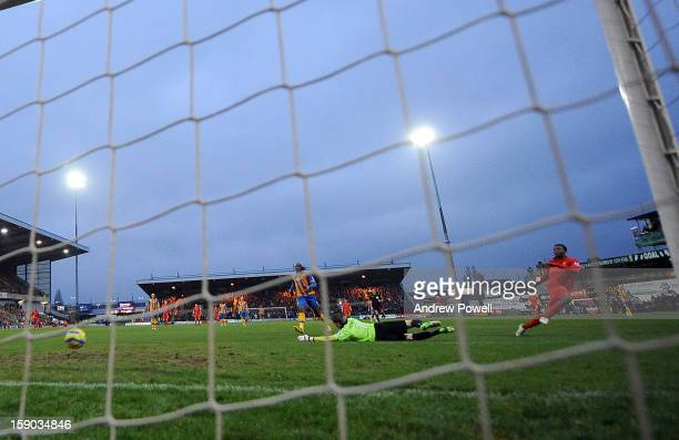 Daniel Sturridge of Liverpool scores the opening goal during the FA Cup Third Round match between Mansfield Town and Liverpool at One Call Stadium on...
