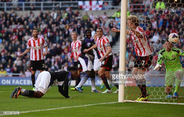 Daniel Sturridge of Liverpool scores the opening goal during the Barclays Premier League match between Sunderland and Liverpool at the Stadium of...