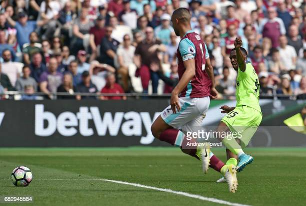 Daniel Sturridge of Liverpool scores the opening goal during the Premier League match between West Ham United and Liverpool at London Stadium on May...