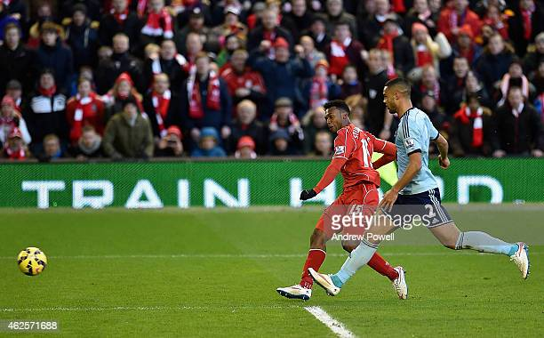 Daniel Sturridge of Liverpool scores the second goal during the Barclays Premier League match between Liverpool and West Ham United at Anfield on...