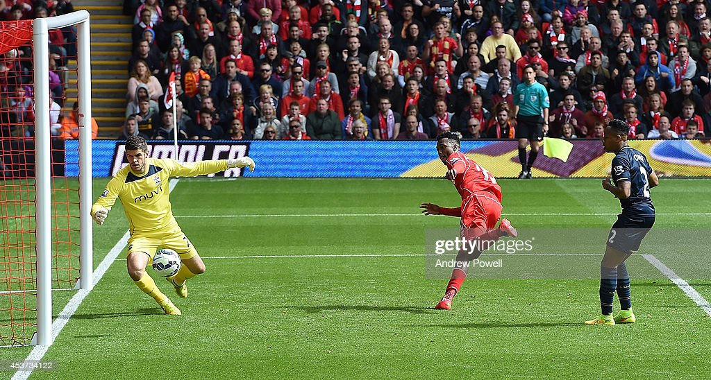 Daniel Sturridge of Liverpool scores the second goal for Liverpool during the Premier League match between Liverpool and Southampton at Anfield on August 17, 2014 in Liverpool, England.