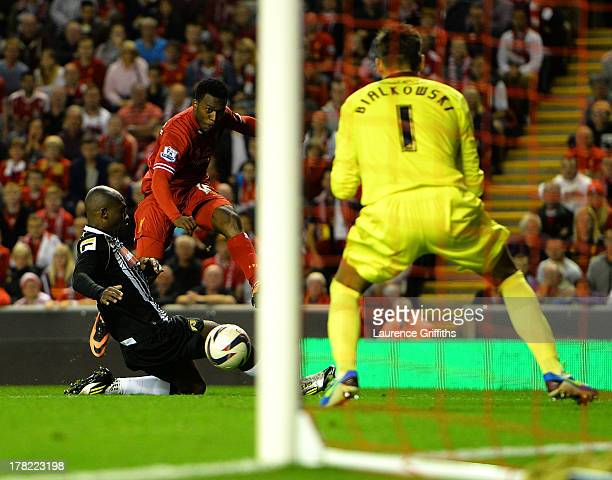 Daniel Sturridge of Liverpool scores the third goal past keeper Bartosz Bialkowski of Notts County during the Capital One Cup Second Round between...