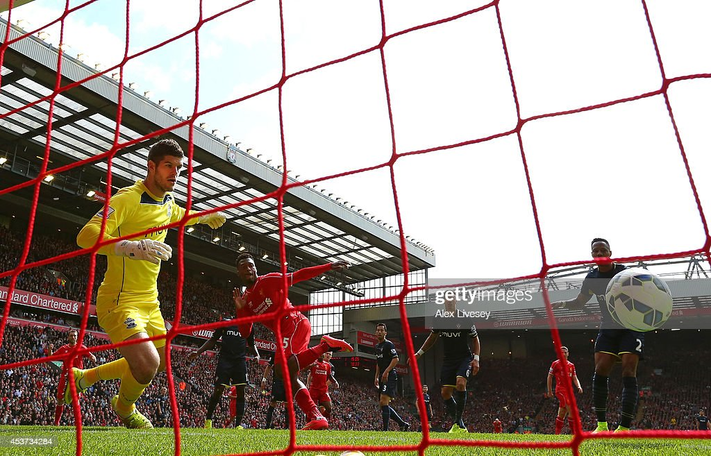 Daniel Sturridge of Liverpool scores the winning goal past Fraser Forster of Southampton during the Barclays Premier League match between Liverpool and Southampton at Anfield on August 17, 2014 in Liverpool, England.