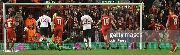 Daniel Sturridge of Liverpool scores their first goal during the UEFA Europa League round of 16 first leg match between Liverpool and Manchester...