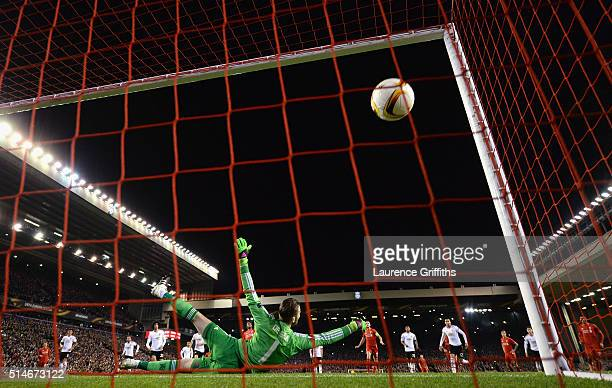 Daniel Sturridge of Liverpool scores their first goal from the penalty spot past goalkeeper David De Gea of Manchester United during the UEFA Europa...