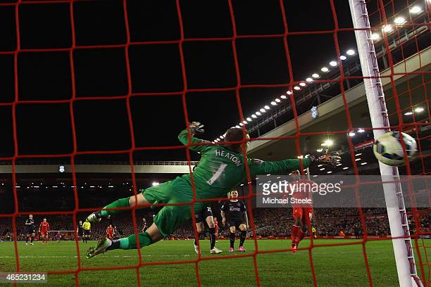 Daniel Sturridge of Liverpool scores their second goal past Thomas Heaton of Burnley during the Barclays Premier League match between Liverpool and...