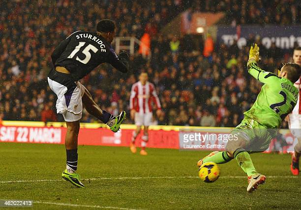 Daniel Sturridge of Liverpool shoots past Jack Butland of Stoke City as he scores their fifth goal during the Barclays Premier League match between...