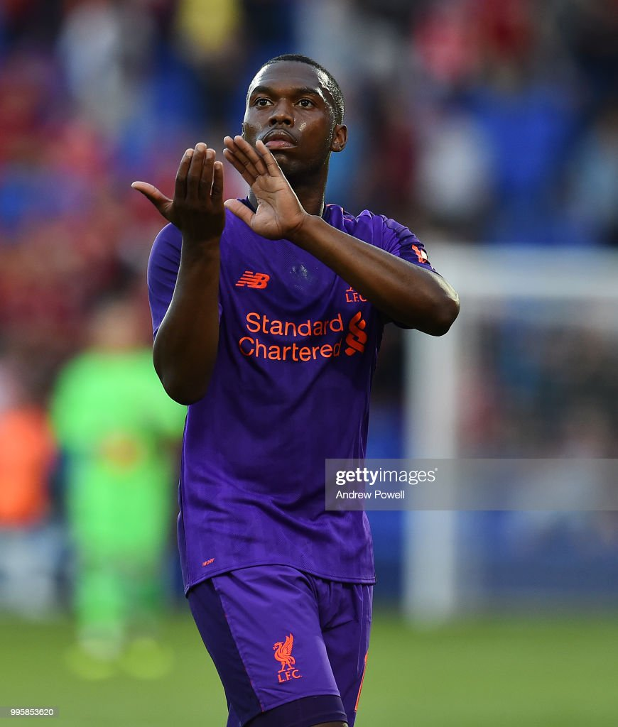Daniel Sturridge of Liverpool shows his appreciation to the fans at the end of the pre-season friendly match between Tranmere Rovers and Liverpool at Prenton Park on July 10, 2018 in Birkenhead, England.