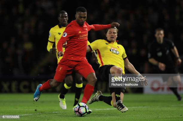Daniel Sturridge of Liverpool takes a shot on goal under pressure from Sebastian Prodl of Watford during the Premier League match between Watford and...