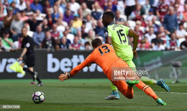 Daniel Sturridge of Liverpool takes it around Adrian of West Ham United to score the opening goal during the Premier League match between West Ham...