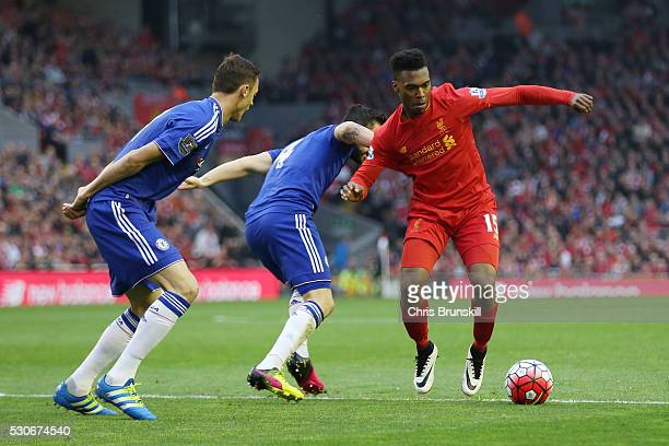Daniel Sturridge of Liverpool takes on the Chelsea defence during the Barclays Premier League match between Liverpool and Chelsea at Anfield on May...