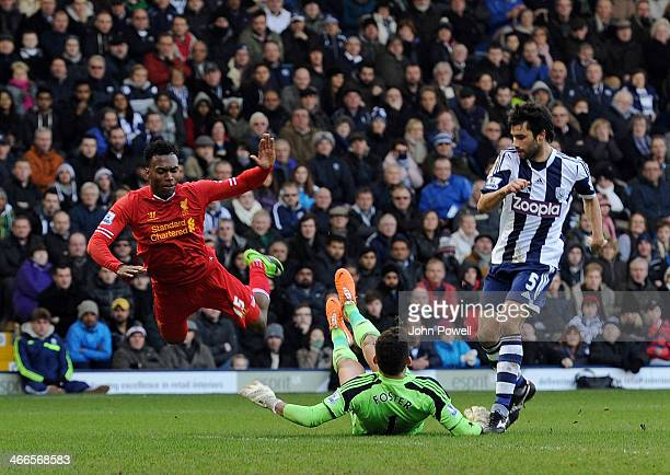 Daniel Sturridge of Liverpool tumbels over Ben Foster of West Bromwich Albion during the Barclays Premier Leauge match between West Bromwich Albion...
