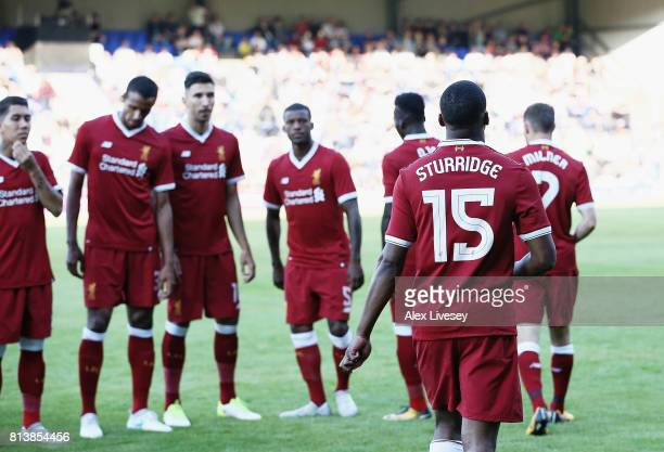 Daniel Sturridge of Liverpool walks out with team mates prior to a preseason friendly match between Tranmere Rovers and Liverpool at Prenton Park on...