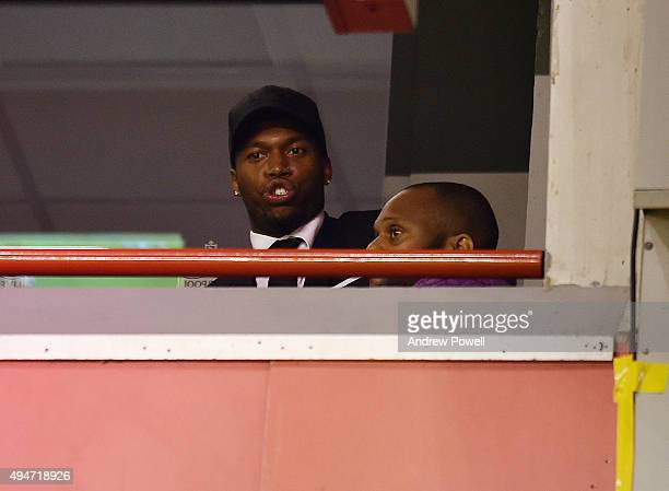 Daniel Sturridge of Liverpool watches from a box during the Capital One Cup Fourth Round match between Liverpool and AFC Bournemouth at Anfield on...
