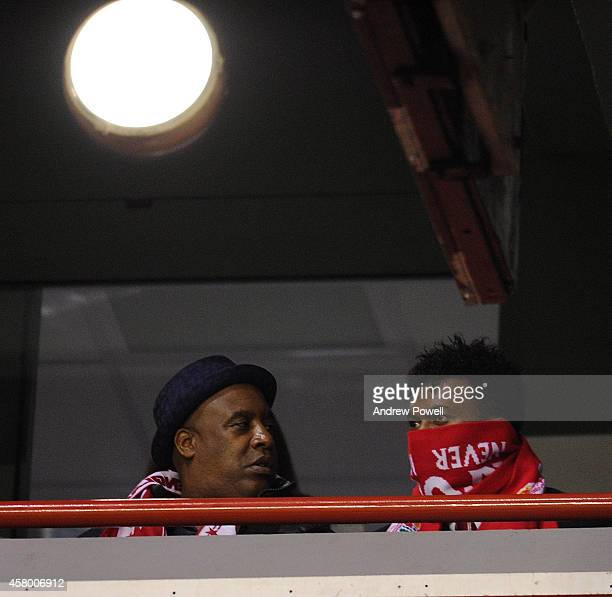 Daniel Sturridge of Liverpool watches from the stands during the Capital One Cup Fourth Round match between Liverpool and Swansea City at Anfield on...