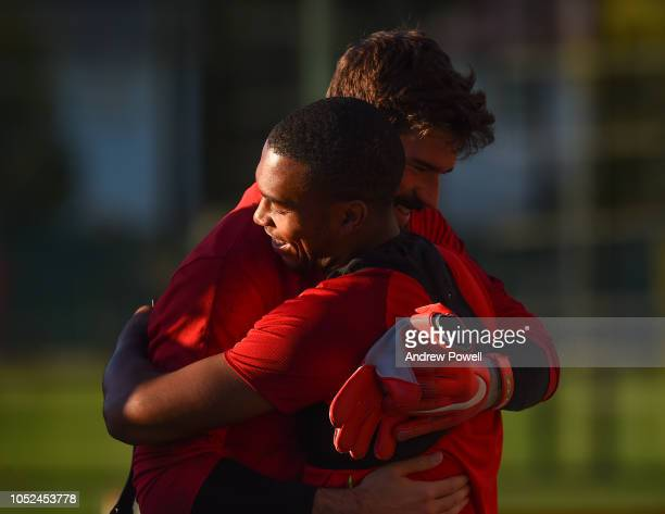Daniel Sturridge of Liverpool with Alisson Becker during a training session at Melwood Training Ground on October 18 2018 in Liverpool England