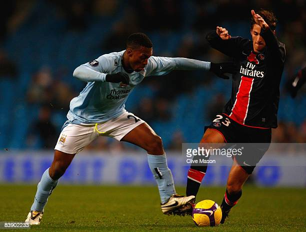 Daniel Sturridge of Manchester City battles for the ball with Jeremy Clement of Paris Saint Germain during the UEFA Cup Group A match between...