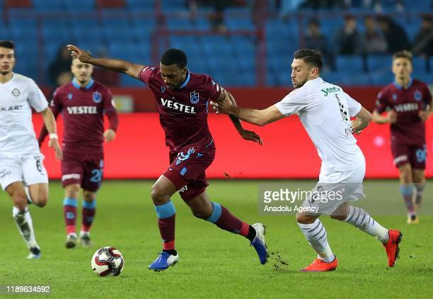Daniel Sturridge of Trabzonspor and Deniz Vural of Altay vie for the ball during Ziraat Turkish Cup 5th round soccer match between Trabzonspor and...