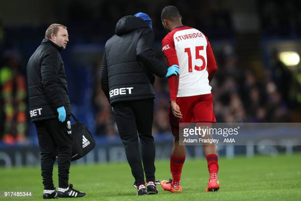 Daniel Sturridge of West Bromwich Albion leaves the field injured during the Premier League match between Chelsea and West Bromwich Albion at...