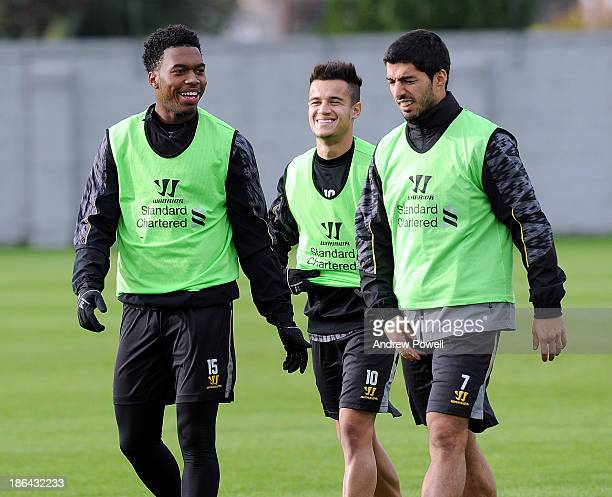 Daniel Sturridge Philippe Coutinho and Luis Suarez of Liverpool laughing during a training session at Melwood Training Ground on October 31 2013 in...