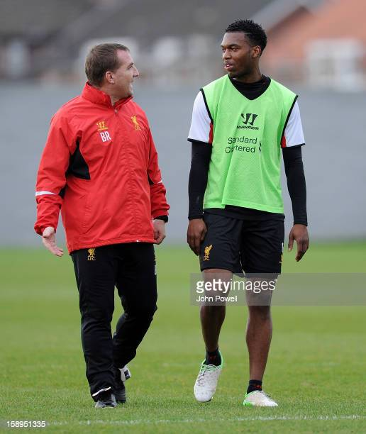 Daniel Sturridge talks with Brendan Rodgers manager of Liverpool in action during a training session at Melwood Training Ground on January 4 2013 in...