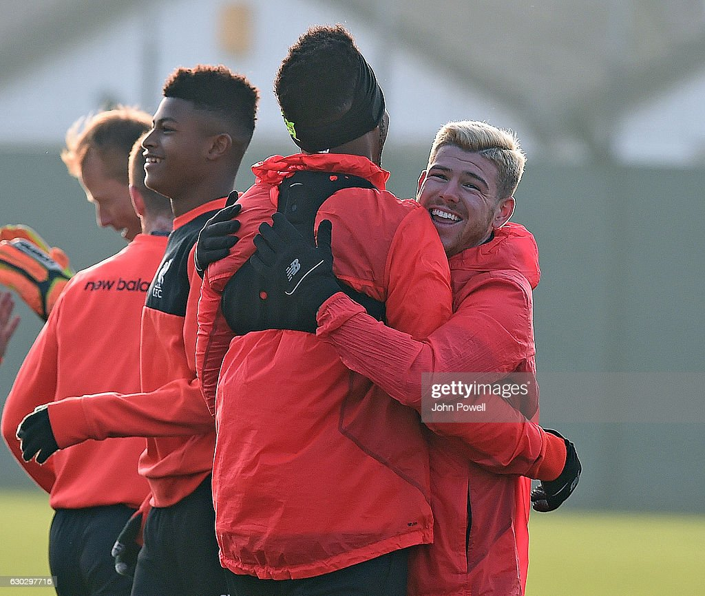 Daniel Sturridge with Alberto Moreno of Liverpool during a training session at Melwood Training Ground on December 20, 2016 in Liverpool, England.
