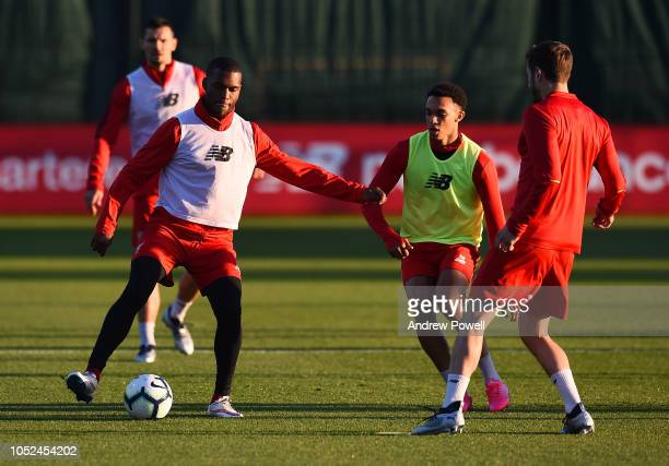 Daniel Sturrige and Trent AlexanderArnold of Liverpool during a training session at Melwood Training Ground on October 18 2018 in Liverpool England