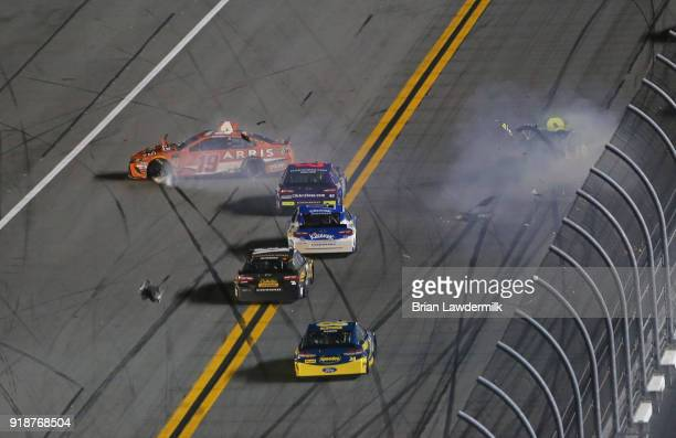 Daniel Suarez driver of the ARRIS Toyota and Jimmie Johnson driver of the Lowe's for Pros Chevrolet wreck during the Monster Energy NASCAR Cup Series...