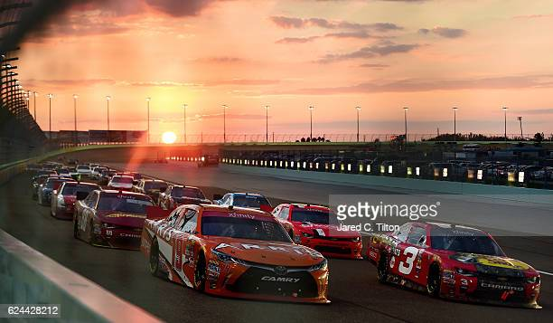 Daniel Suarez driver of the ARRIS Toyota and Ty Dillon driver of the Bass Pro Shops Chevrolet lead a pack of cars during the NASCAR XFINITY Series...