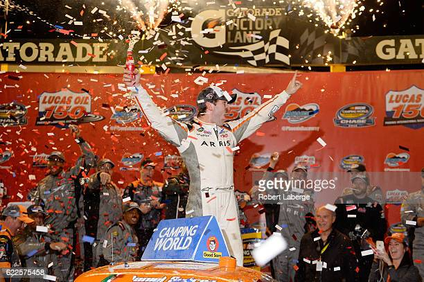 Daniel Suarez driver of the ARRIS Toyota celebrates in Victory Lane after winning the NASCAR Camping World Truck Series Lucas Oil 150 at Phoenix...
