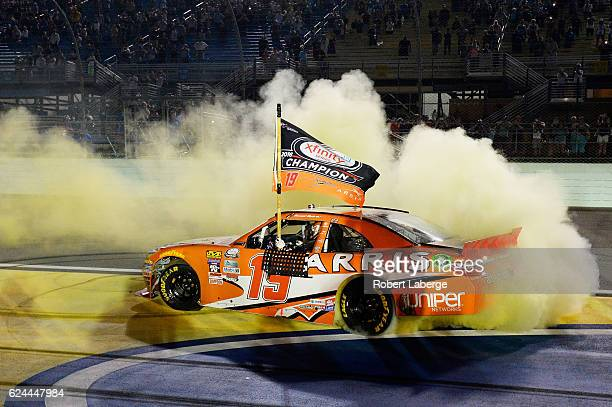 Daniel Suarez driver of the ARRIS Toyota celebrates with a burnout after winning the NASCAR XFINITY Series Ford EcoBoost 300 and the NASCAR XFINITY...