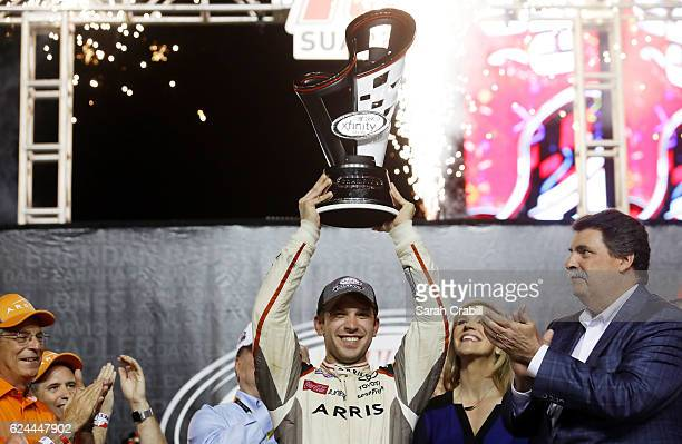 Daniel Suarez driver of the ARRIS Toyota celebrates with the NASCAR XFINITY Series Championship trophy in Victory Lane after winning the NASCAR...