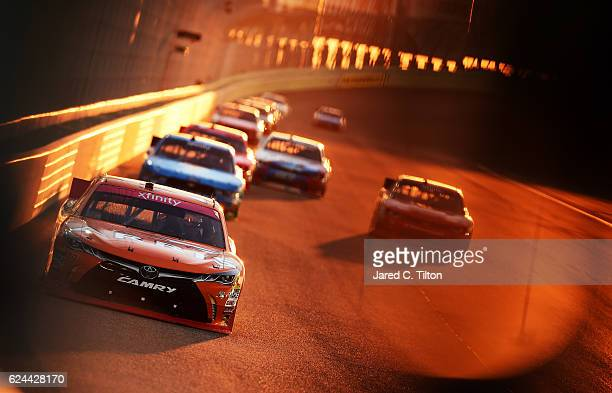 Daniel Suarez driver of the ARRIS Toyota leads a pack of cars during the NASCAR XFINITY Series Ford EcoBoost 300 at HomesteadMiami Speedway on...