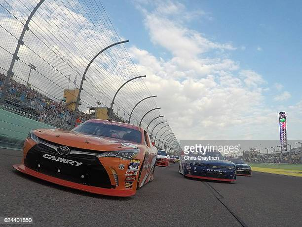 Daniel Suarez driver of the ARRIS Toyota leads the field at the start of the NASCAR XFINITY Series Ford EcoBoost 300 at HomesteadMiami Speedway on...