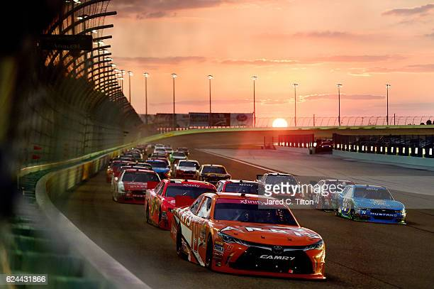 Daniel Suarez driver of the ARRIS Toyota leads the field during the NASCAR XFINITY Series Ford EcoBoost 300 at HomesteadMiami Speedway on November 19...