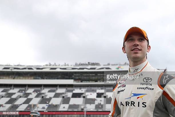 Daniel Suarez driver of the ARRIS Toyota looks on from the grid during qualifying for the NASCAR XFINITY Series Alert Today Florida 300 at Daytona...