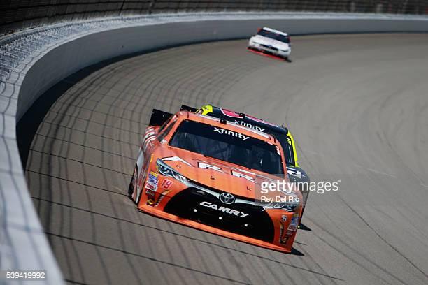Daniel Suarez driver of the ARRIS Toyota races Paul Menard driver of the Richmond/Menards Chevrolet during the NASCAR XFINITY Series Menards 250 at...