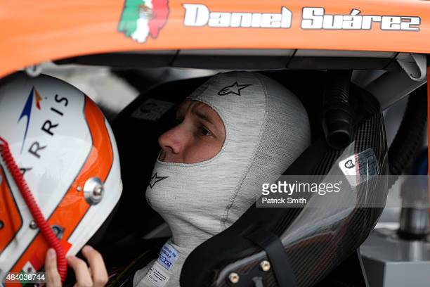 Daniel Suarez driver of the ARRIS Toyota sits in his car in the garage area during qualifying for the NASCAR XFINITY Series Alert Today Florida 300...