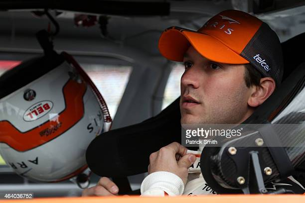 Daniel Suarez driver of the ARRIS Toyota sits in his car on the grid during qualifying for the NASCAR XFINITY Series Alert Today Florida 300 at...