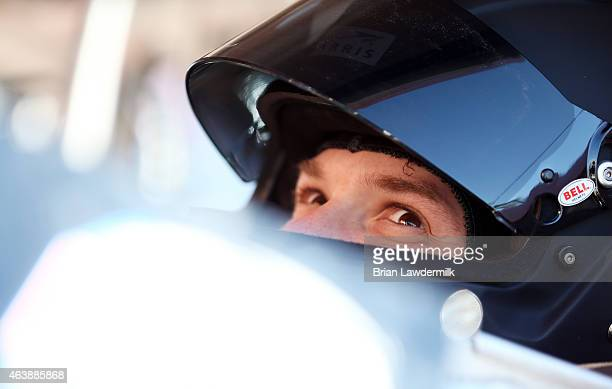 Daniel Suarez driver of the ARRIS Toyota sits in his truck in the garage area during practice for the NASCAR Camping World Truck Series NextEra...