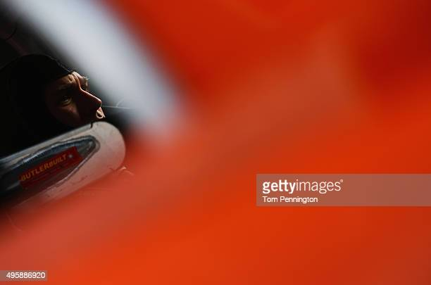 Daniel Suarez driver of the ARRIS Toyota sits in his truck in the garage area during practice for the NASCAR Camping World Truck Series Winstar World...