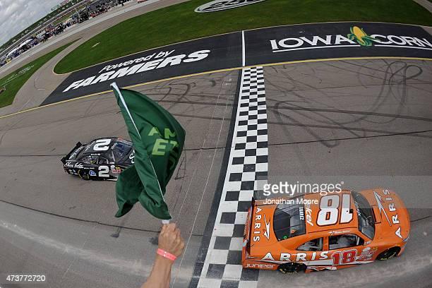 Daniel Suarez driver of the ARRIS Toyota takes the green flag to start the NASCAR XFinity Series 3M 250 at Iowa Speedway on May 17 2015 in Newton Iowa