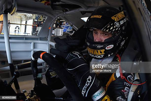 Daniel Suarez driver of the DEWALT FLEXVOLT Toyota sits in his car during practice for the NASCAR XFINITY Series VysitMyrtleBeachcom 300 at Kentucky...