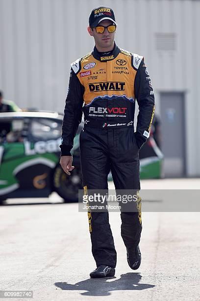 Daniel Suarez driver of the DEWALT FLEXVOLT Toyota walks in the garage during practice for the NASCAR XFINITY Series VysitMyrtleBeachcom 300 at...