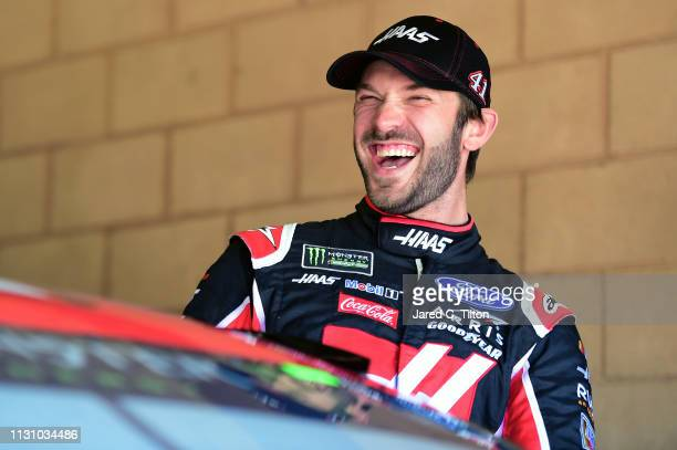 Daniel Suarez driver of the Haas Automation Ford shares a smile during practice for the Monster Energy NASCAR Cup Series Auto Club 400 at Auto Club...