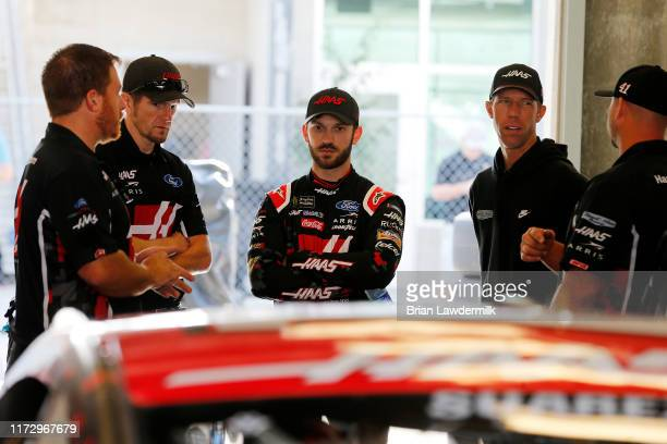 Daniel Suarez driver of the Haas Automation Ford stands in the garage during practice for the Monster Energy NASCAR Cup Series Big Machine Vodka 400...