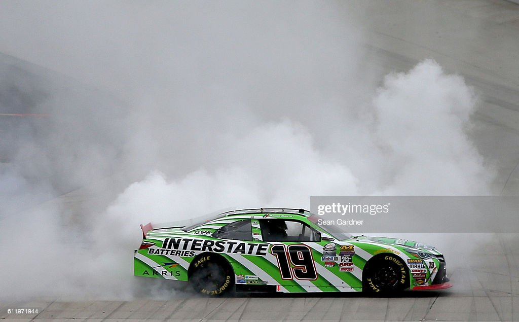 Daniel Suarez, driver of the #19 Interstate Batteries Toyota, celebrates with a burnout after winning the NASCAR XFINITY Series Drive Sober 200 at Dover International Speedway on October 2, 2016 in Dover, Delaware.